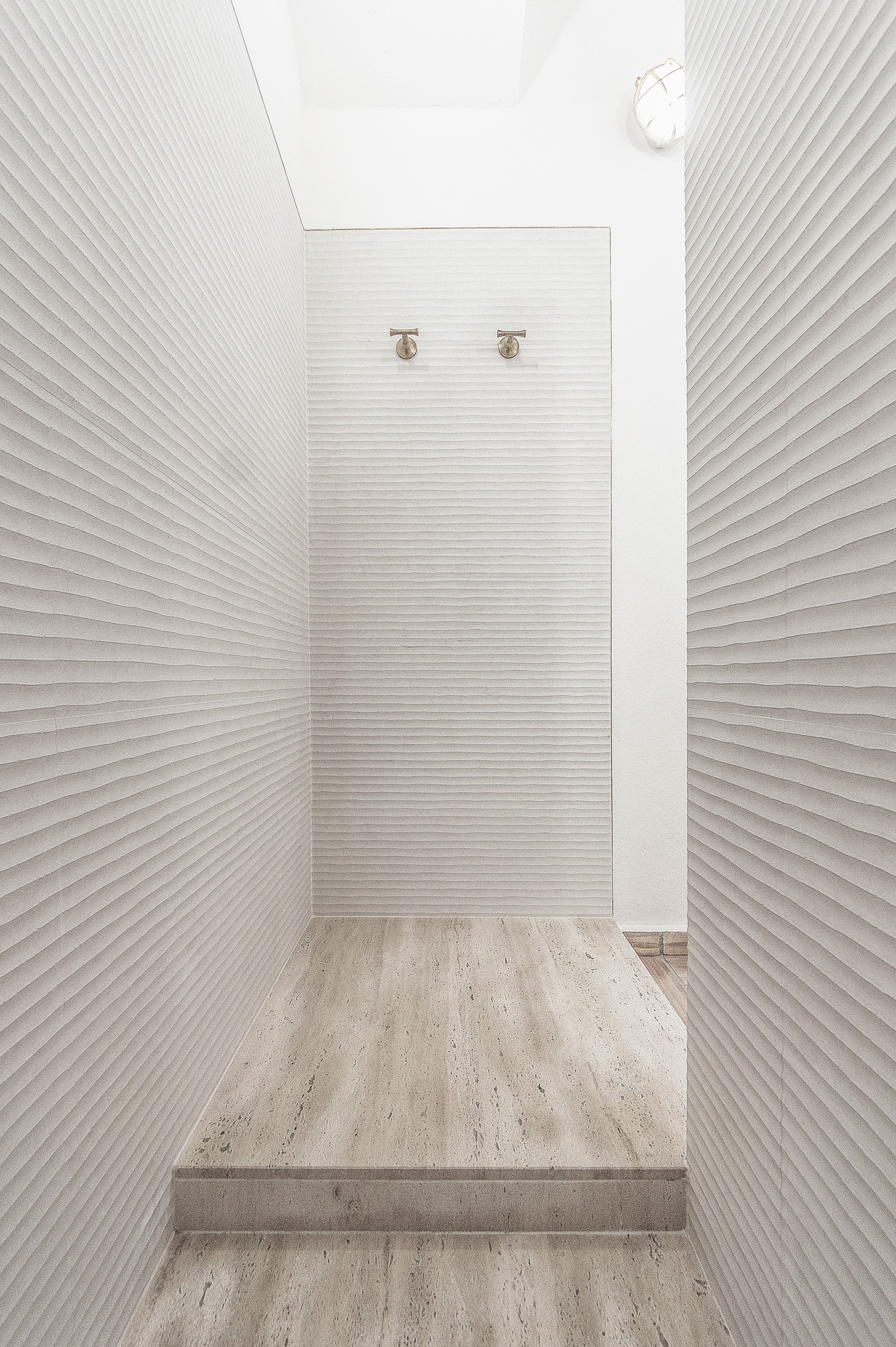 One-piece, solid travetino stone shower base