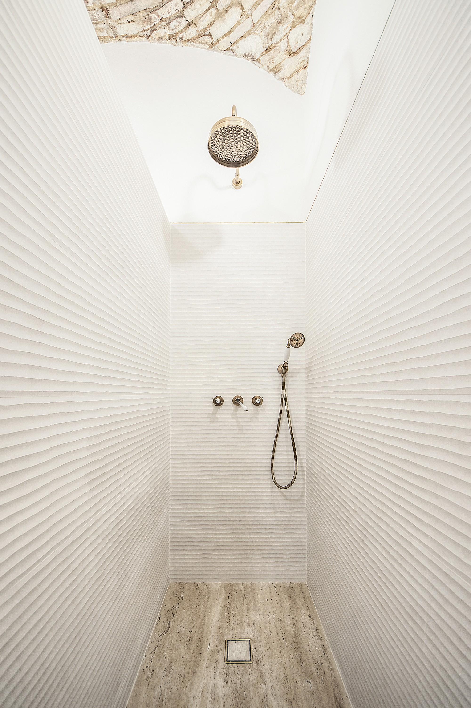 """Brushed brass """"rain shower"""". Travetino stone base"""